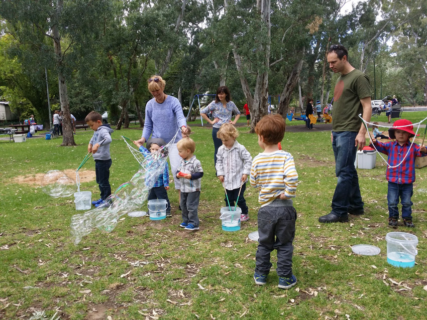 Children playing with Bubbles at kids birthday party with kids party entertainer adelaide
